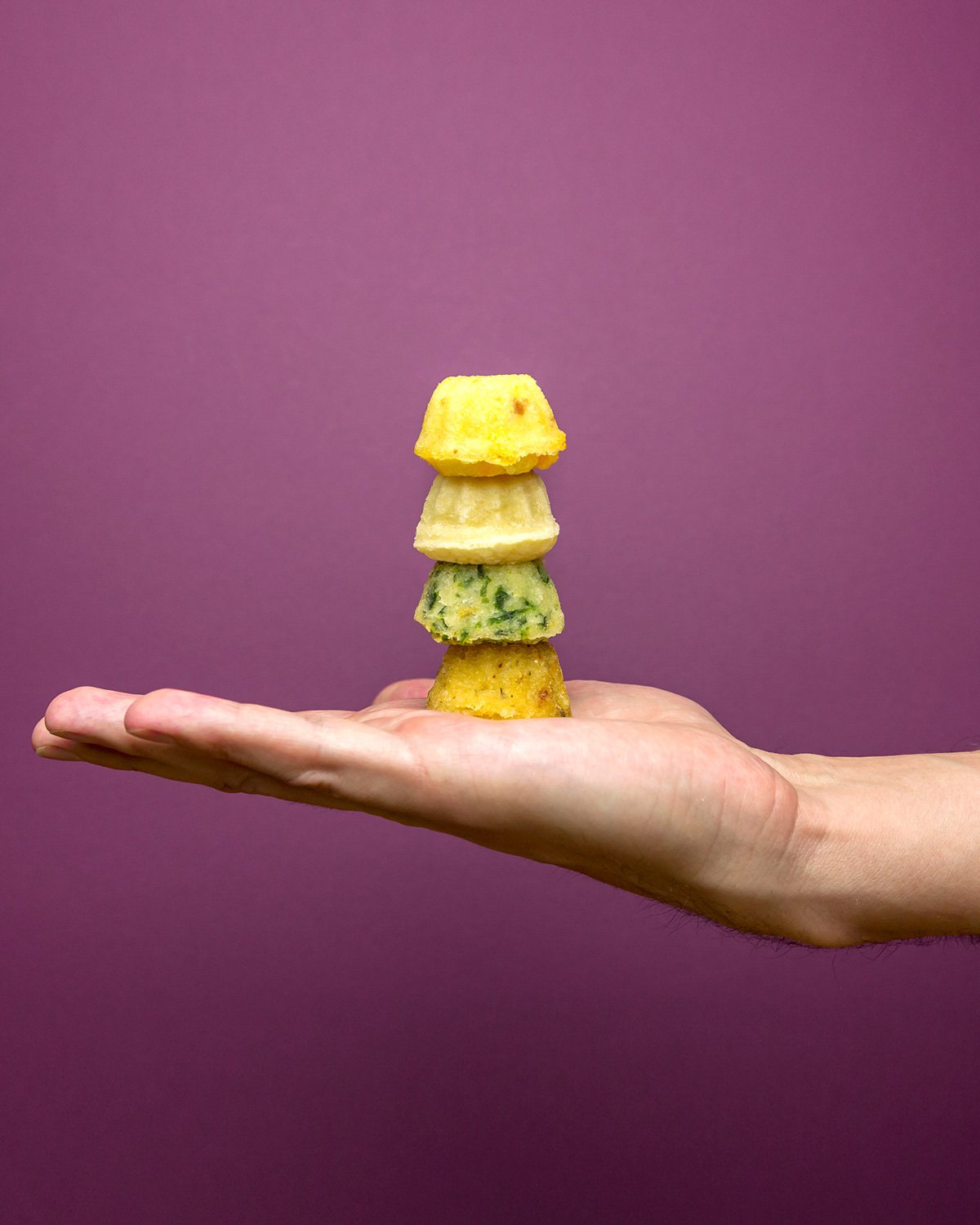 Lil' Franz cakes stacked on hand